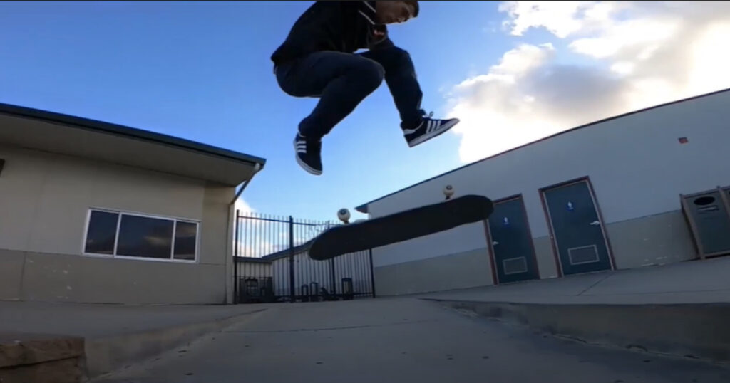 Guy hardflips over the gap at Livermore High School.